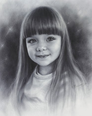 Young girl drawing from photo